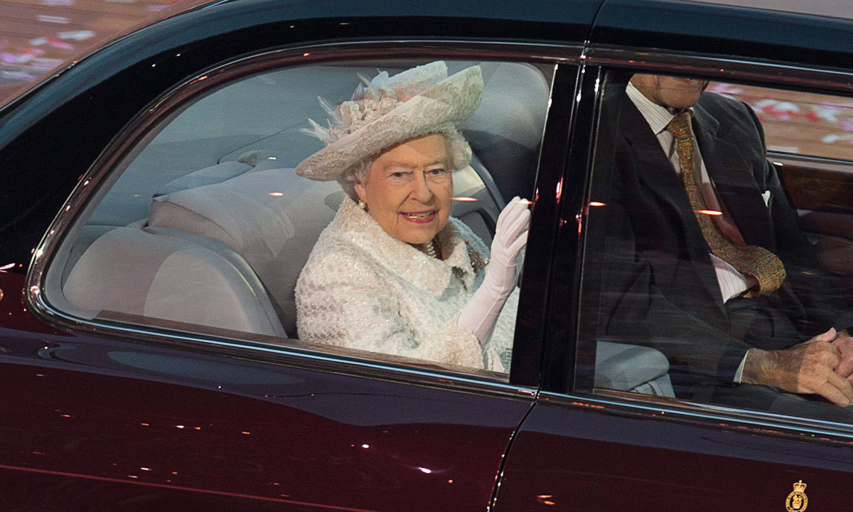 Queen Elizabeth waves from her vehicle as she arrives at the Commonwealth Games opening ceremony at Celtic Park in Glasgow, Scotland on Wednesday, July 23, 2014. — Photo by AP