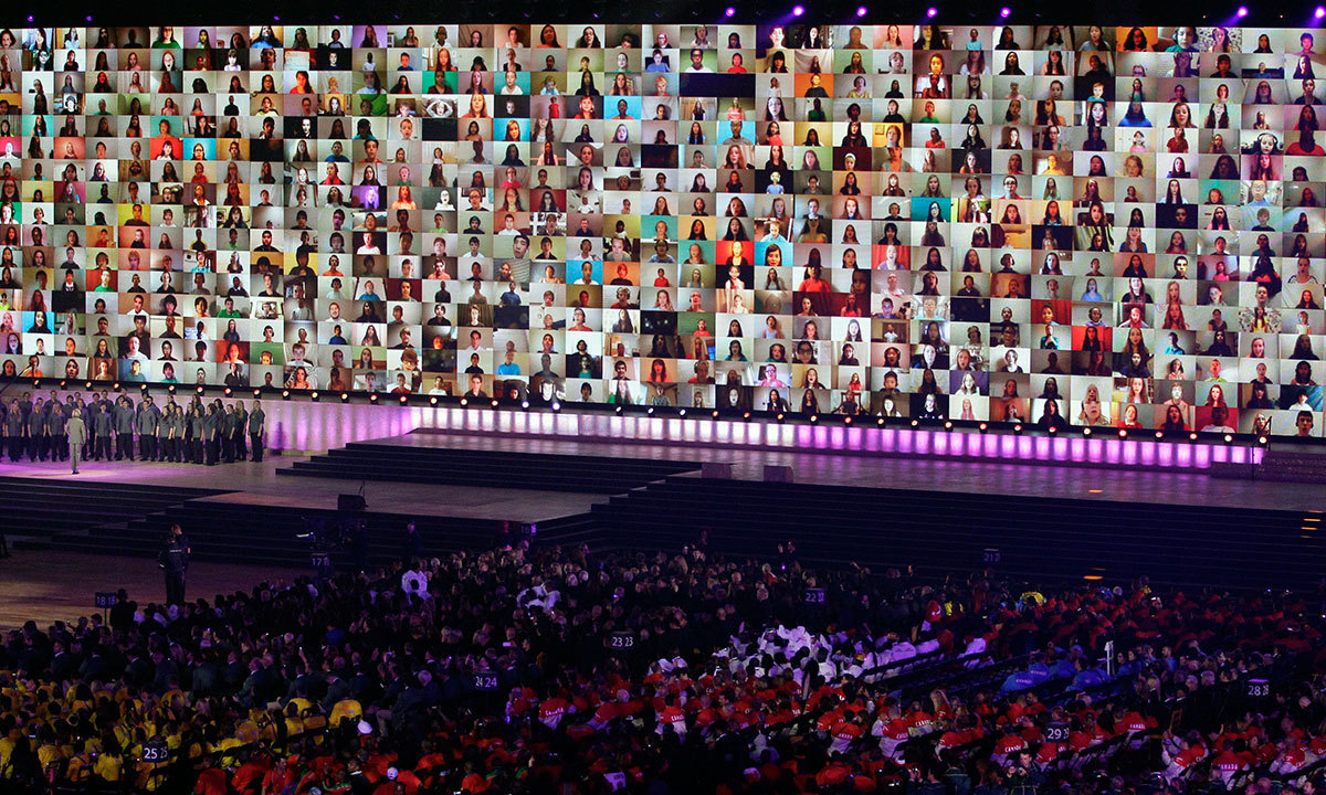 A video wall of faces on screen are displayed during a UNICEF appeal at the opening ceremony for the Commonwealth Games 2014 in Glasgow, Scotland, Wednesday, July 23, 2014. (AP)