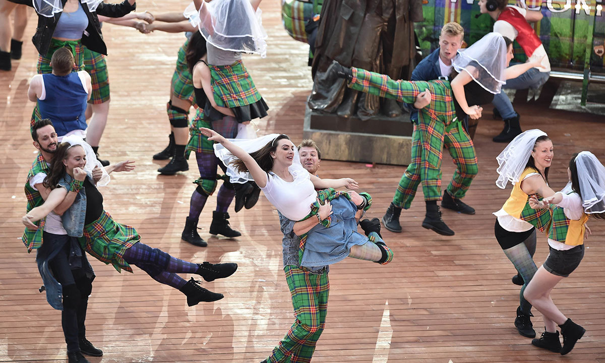 Artists perform during the opening ceremony of the 2014 Commonwealth Games at Celtic Park in Glasgow on July 23, 2014. — Photo by AFP
