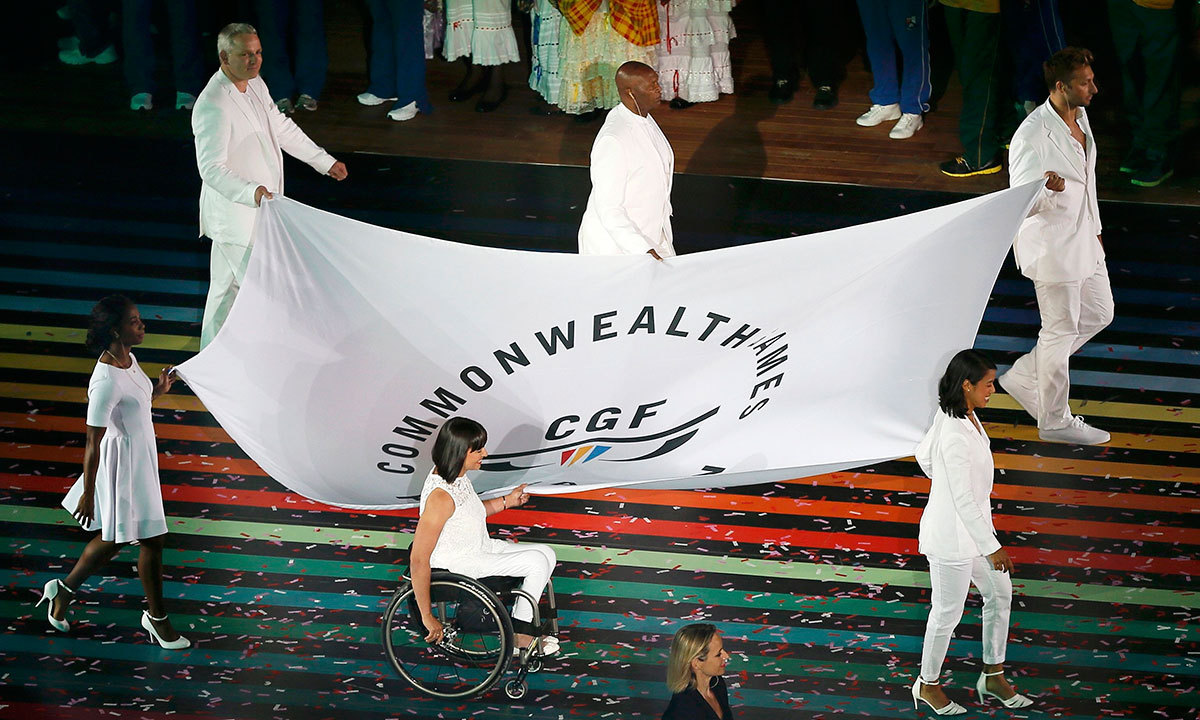 The Commonwealth flag is carried into the stadium during the opening of the 2014 Commonwealth Games at Celtic Park in Glasgow, Scotland, July 23, 2014. — Photo by Reuters