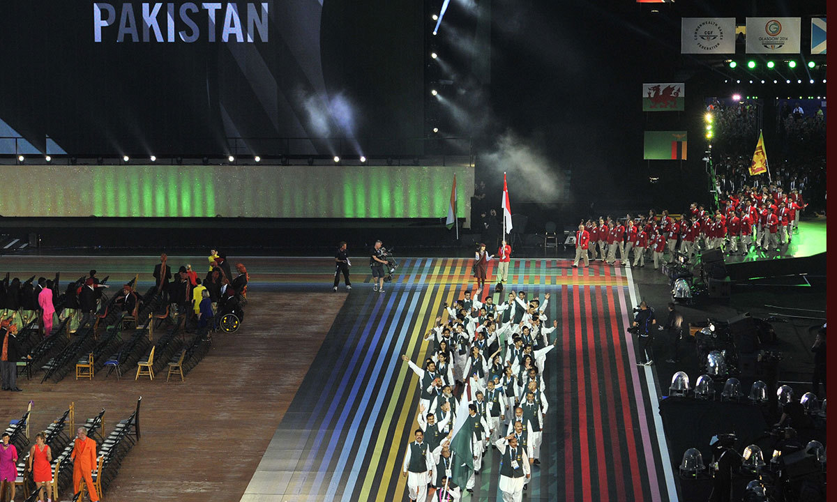 Pakistan's flagbearer Azhar Hussain leads his delegation during the opening ceremony of the 2014 Commonwealth Games at Celtic Park in Glasgow on July 23, 2014. — Photo by AFP