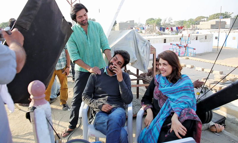 The producer and director on set