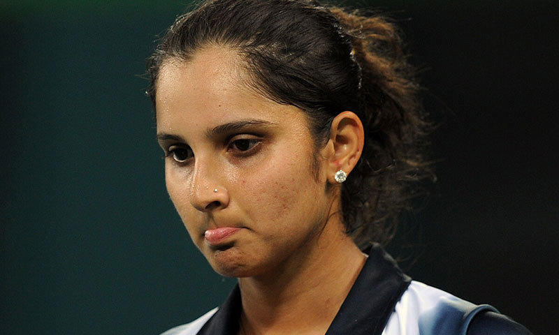 In this photograph taken on Novmeber 21, 2010, Sania Mirza reacts during a match. – AP Photo