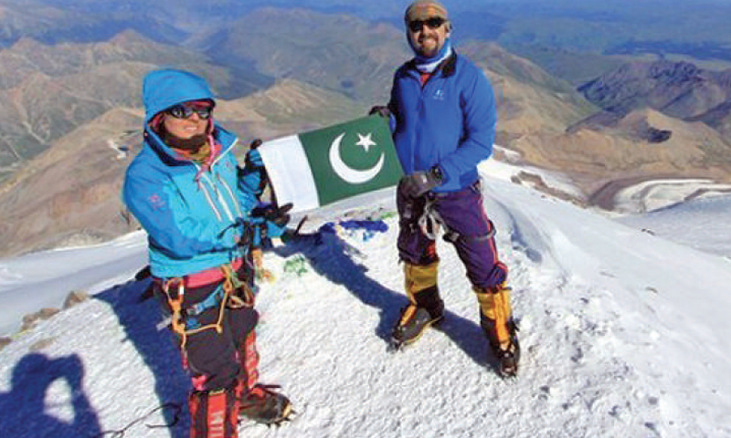 Samina Baig and her brother Mirza Ali raise the Pakistani flag on top of Mt Elbrus, the highest mountain in Europe.