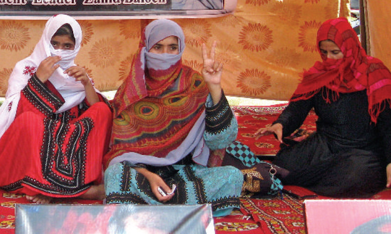 Zarjan and other Baloch women sit in their protest camp outside the National Press Club. —Photo by Ishaque Chaudhry