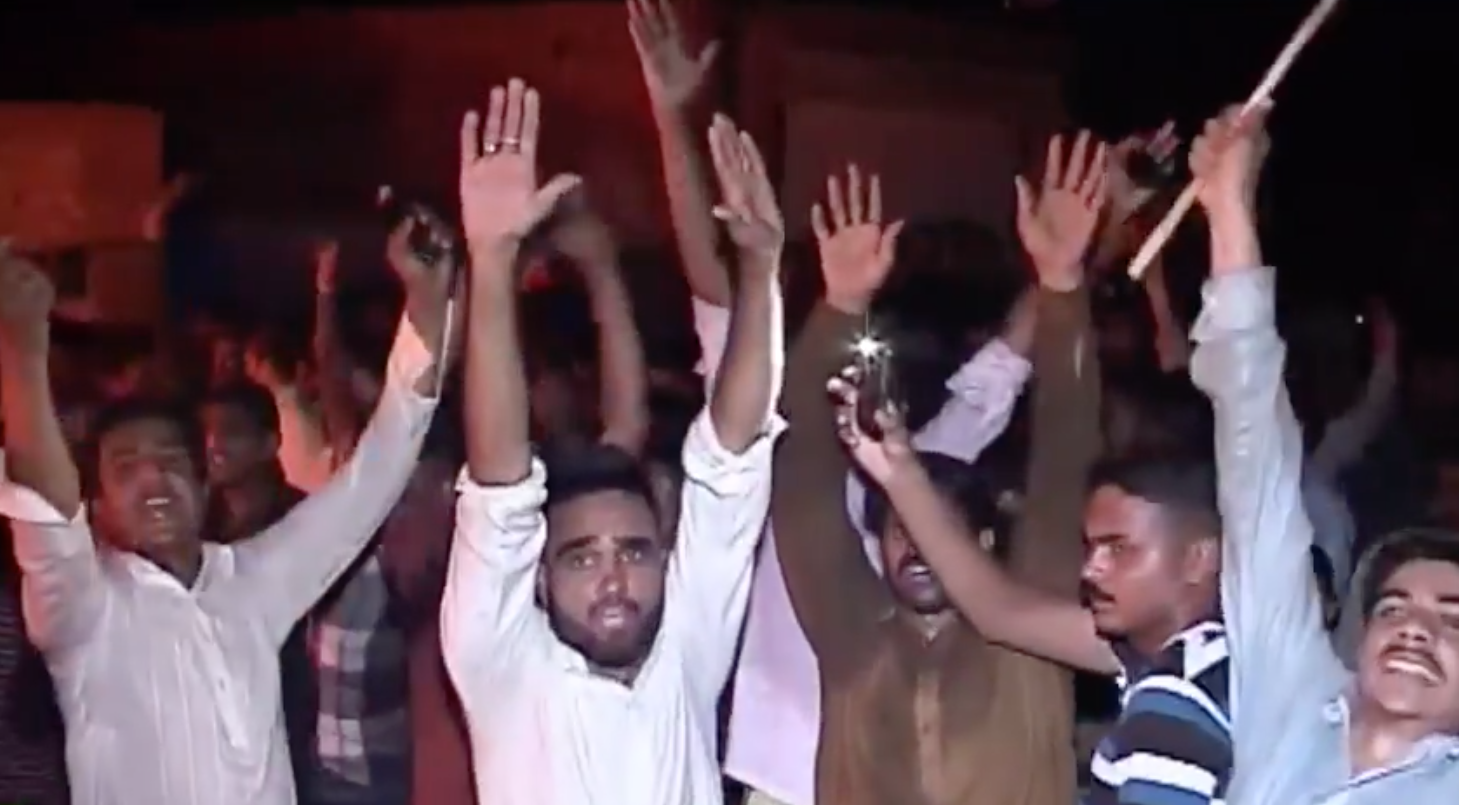 Crowd of attackers cheers on during the attack in Gujranwala. -Screengrab