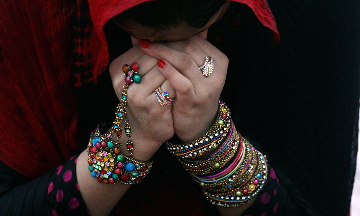 A Pakistani prays at the Badshahi mosque to offer the Eidul Fitr prayer at the beginning of a major holiday marking the end of the fasting month of Ramazan in Lahore, Pakistan, Tuesday, July 29, 2014. — Photo by AP
