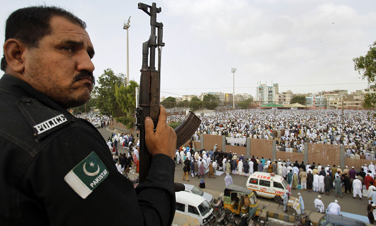 Under tight police security, Pakistani Muslims offer the Eidul Fitr prayer at the beginning of a major holiday marking the end of the fasting month of Ramazan in Karachi, Pakistan, Tuesday, July 29, 2014. — Photo by AP