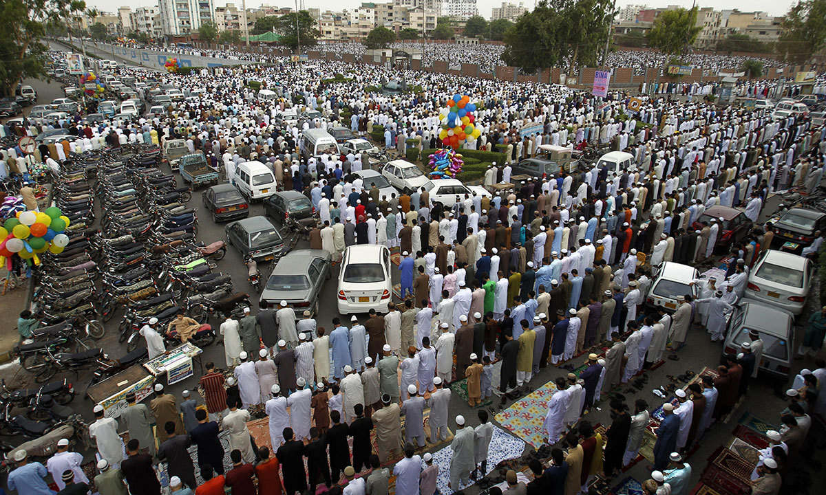 Pakistani Muslims offer the Eidul Fitr prayer at the beginning of a major holiday marking the end of the fasting month of Ramazan in Karachi, Pakistan, Tuesday, July 29, 2014. Millions of Muslims across the world are celebrating the Eid. — Photo by AP