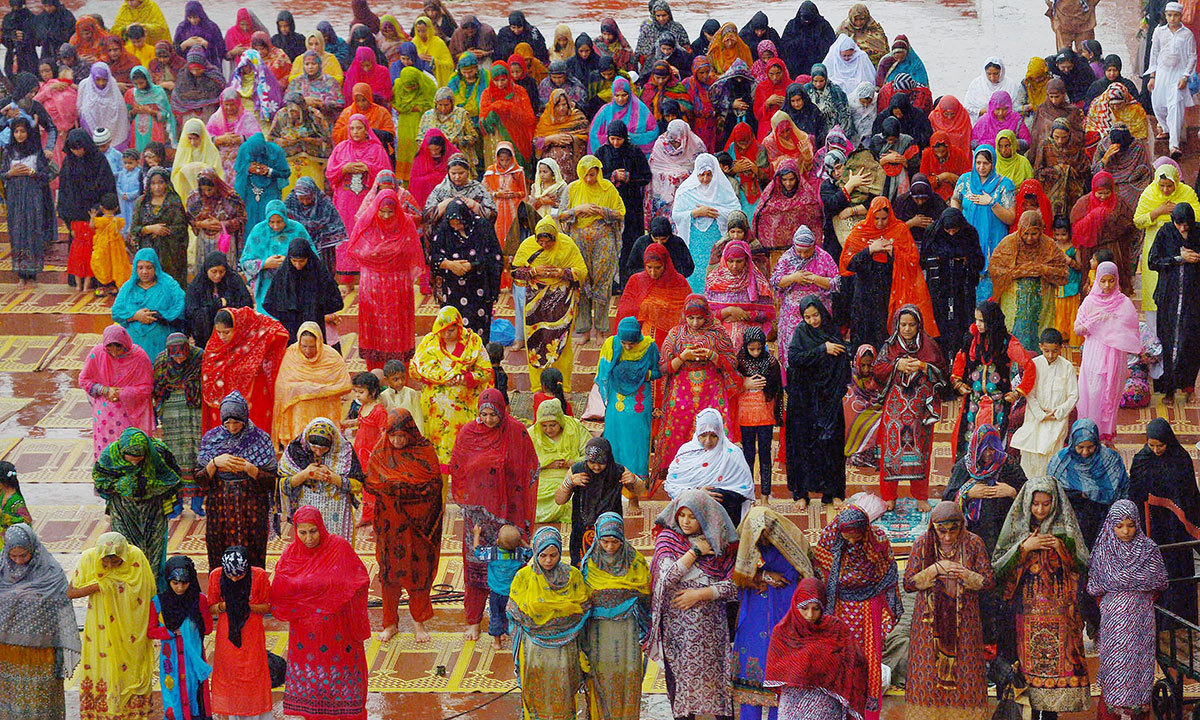 Pakistani Muslim devotees offer Eid prayers on the first day of the Eidul Fitr festival at Badshahi Masjid in Lahore on July 29, 2014.  — Photo by AFP