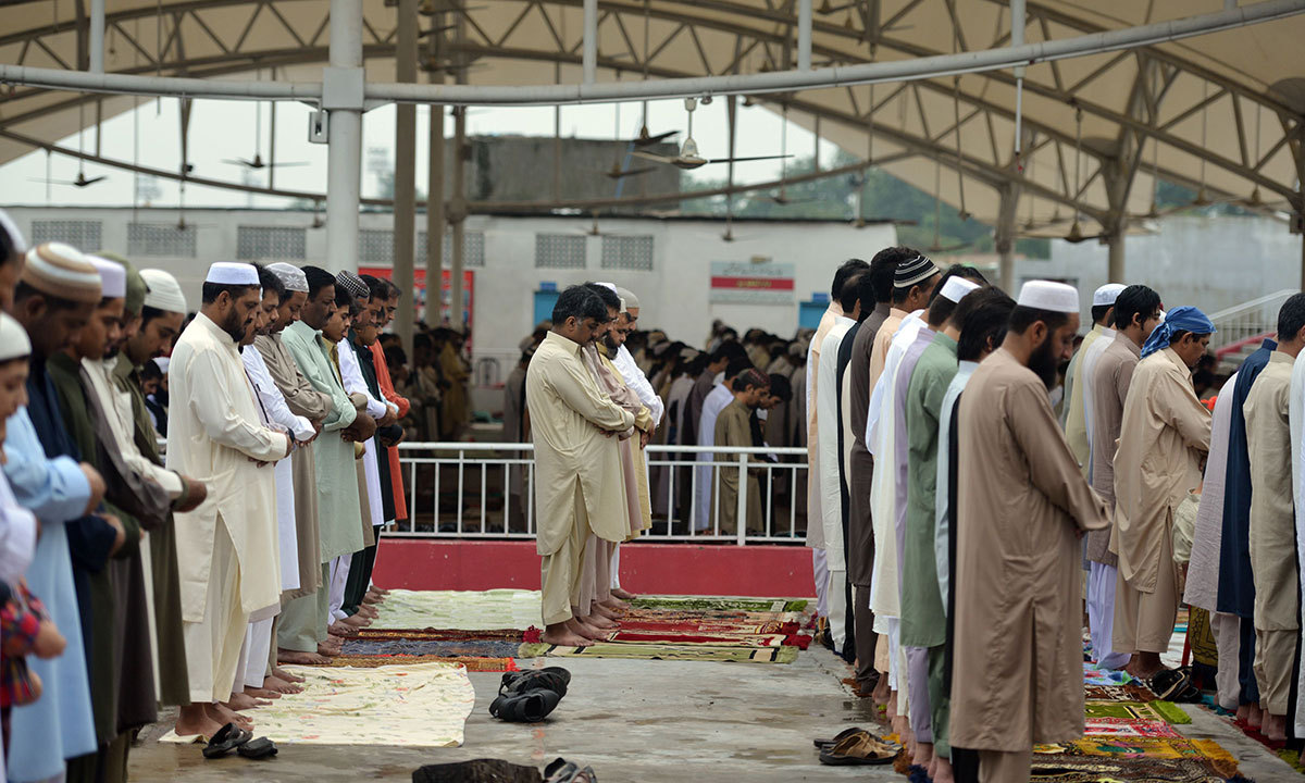 Pakistani Muslims offer Eidul Fitr prayers at the end of the fasting month of Ramazan at the Red Mosque in Islamabad on July 29, 2014. — Photo by AFP
