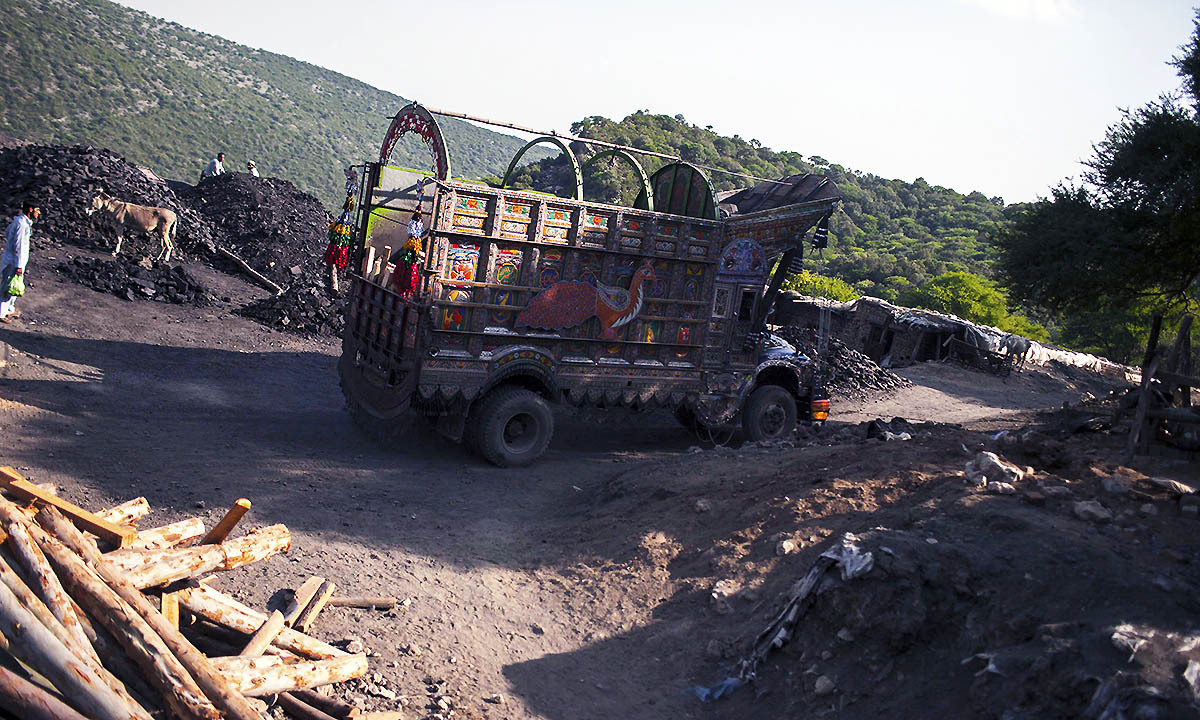 A truck drives past a coal field in Choa Saidan Shah, Punjab province, May 5, 2014.  — Photo by Reuters