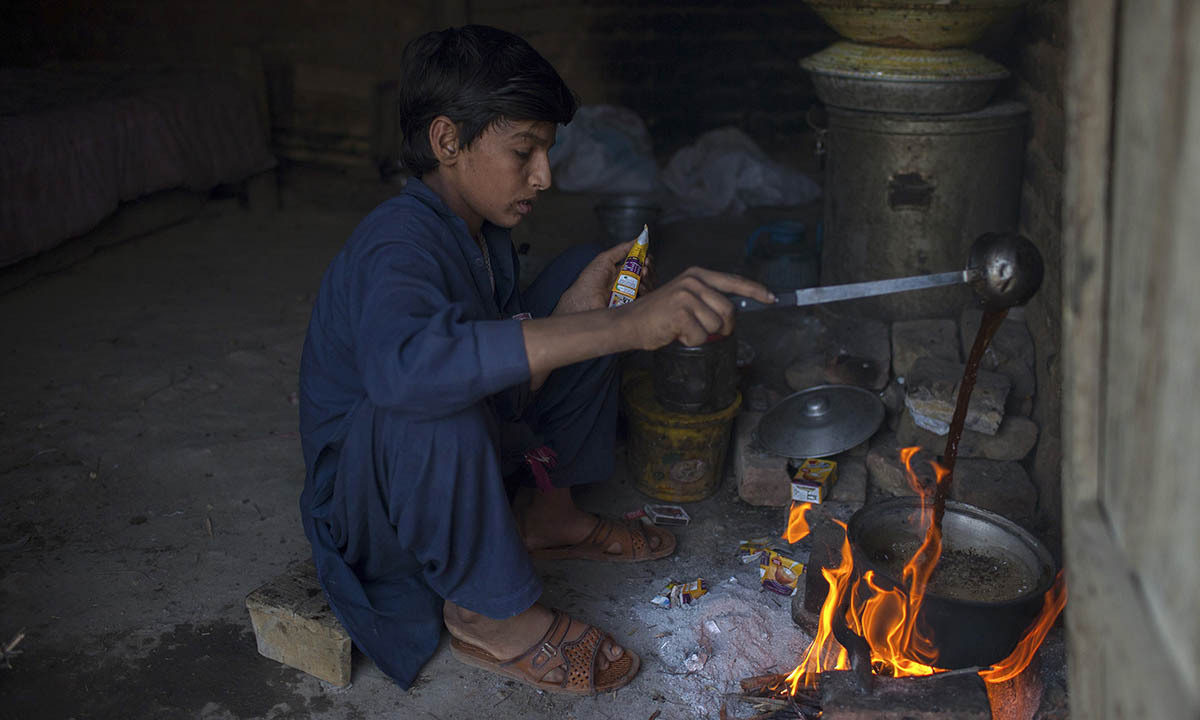 Samiullah prepares tea after finishing work at a coal mine in Choa Saidan Shah, Punjab province, May 5, 2014.  — Photo by Reuters