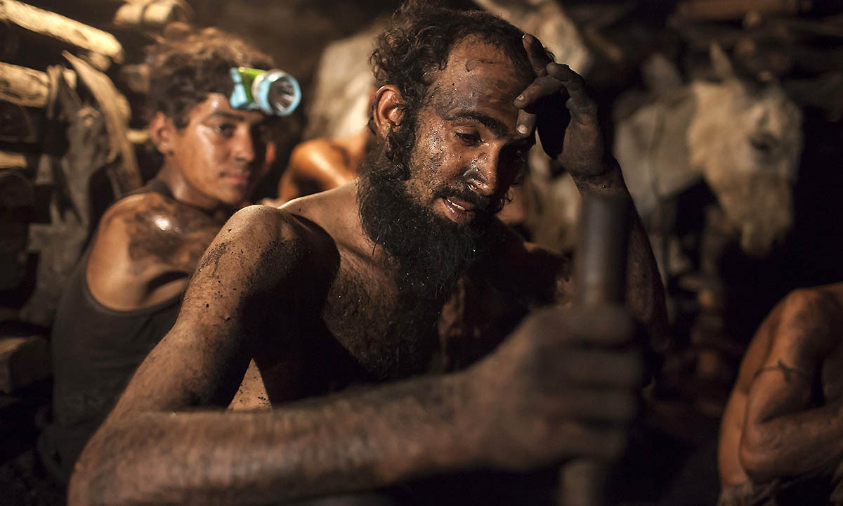 A miner wipes sweat from his forehead inside a coal mine in Choa Saidan Shah, Punjab province, April 29, 2014. — Photo by Reuters