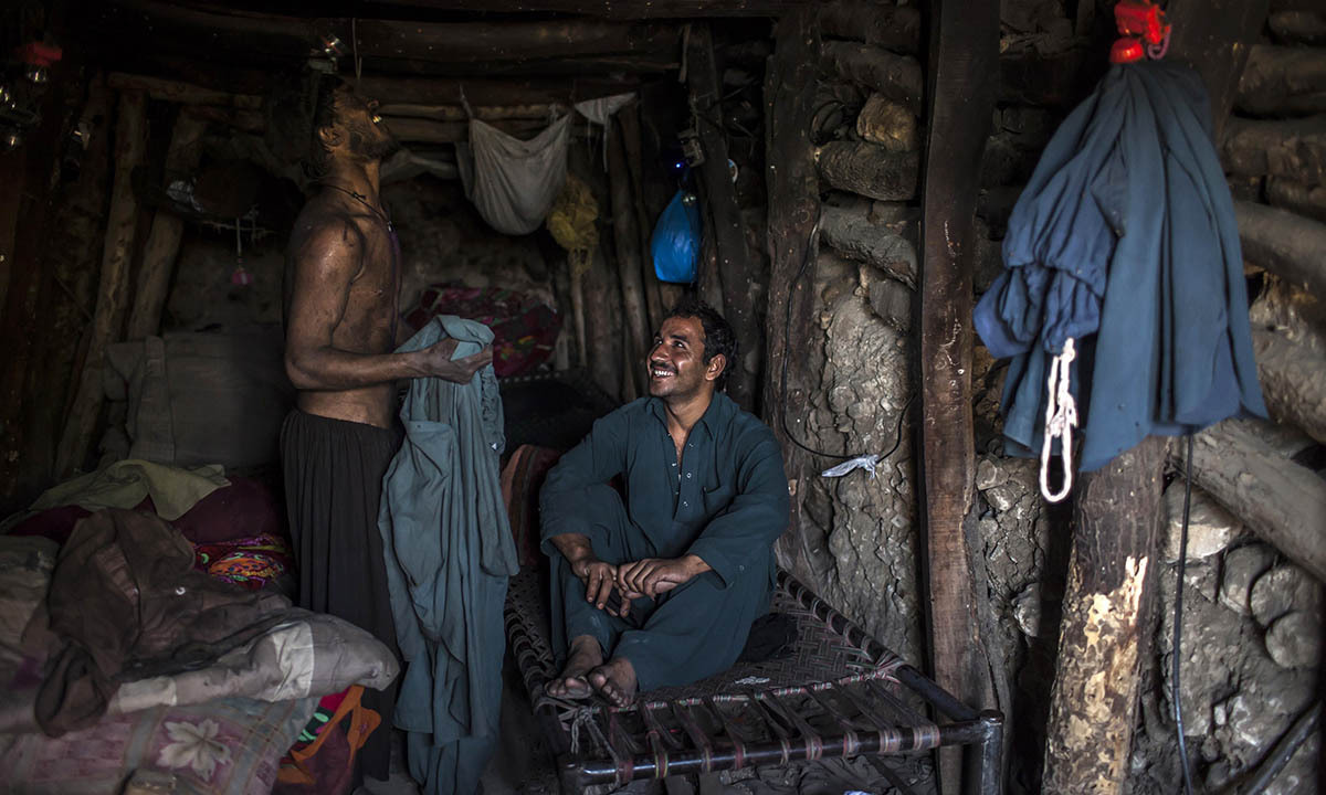 Miners rest in their rooms at the end of the day at a coal field in Choa Saidan Shah, Punjab province, April 29, 2014. — Photo by Reuters