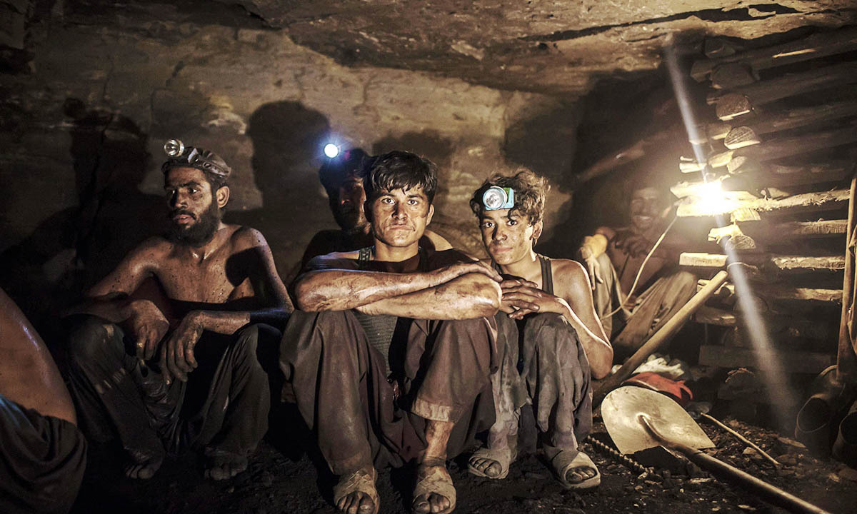 Miners pose for a photograph at the coal face inside a mine in Choa Saidan Shah, Punjab province, April 29, 2014. — Photo by Reuters