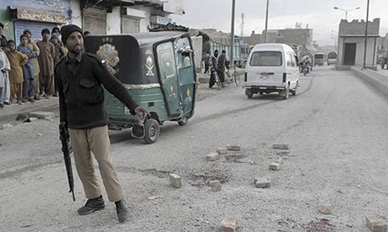 A Pakistani policeman (L) stands guard at the site of an attack by unknown gunmen in Quetta. — File photo by AFP