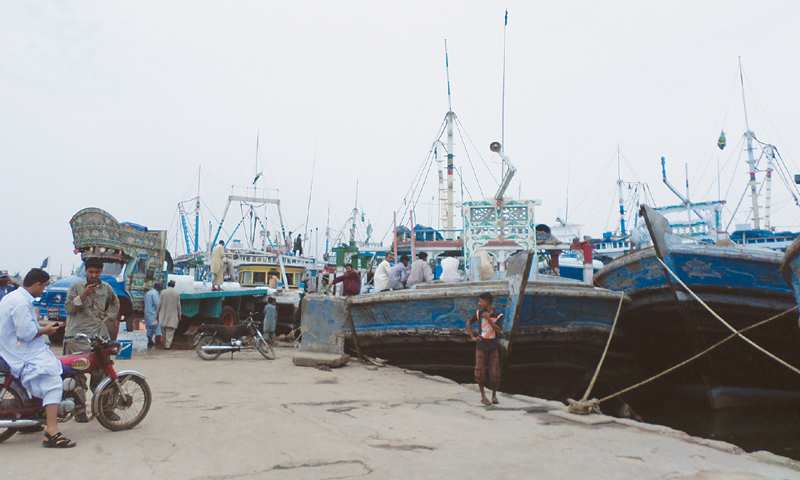 Fishermen on Friday prepare to take on the high seas again as the fishing season resumes after a two-month break.—Photo by author