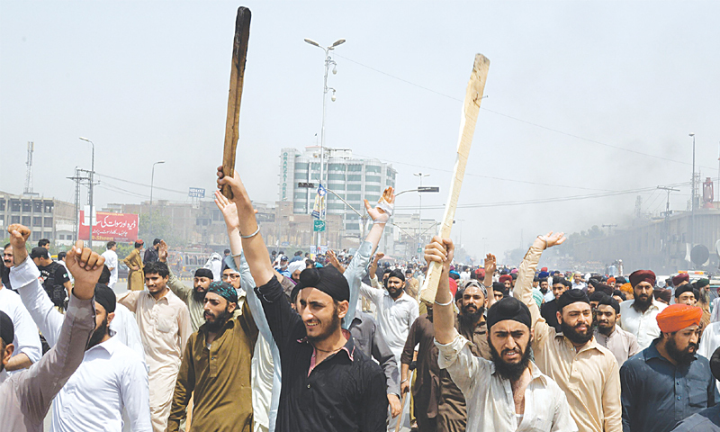 Peshawar: Sikhs protest against the killing of a trader in an attack in a market here on Wednesday.—AFP