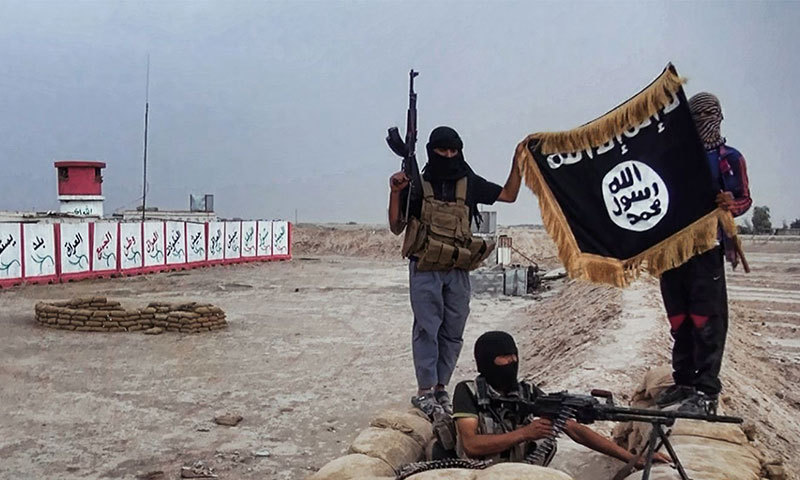 An image made available on the website Welayat Salahuddin shows militants of the Islamic State of Iraq (IS) posing with their trademark flag after allegedly seizing an Iraqi army checkpoint in Iraq. — File photo