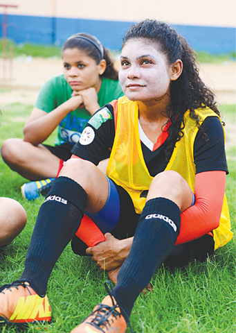 Maldives' Areesha Riza gestures during Balochistan United's team-talk on Thursday. Areesha is the first foreign player to have signed for a women's football club in Pakistan. — Photo by White Star
