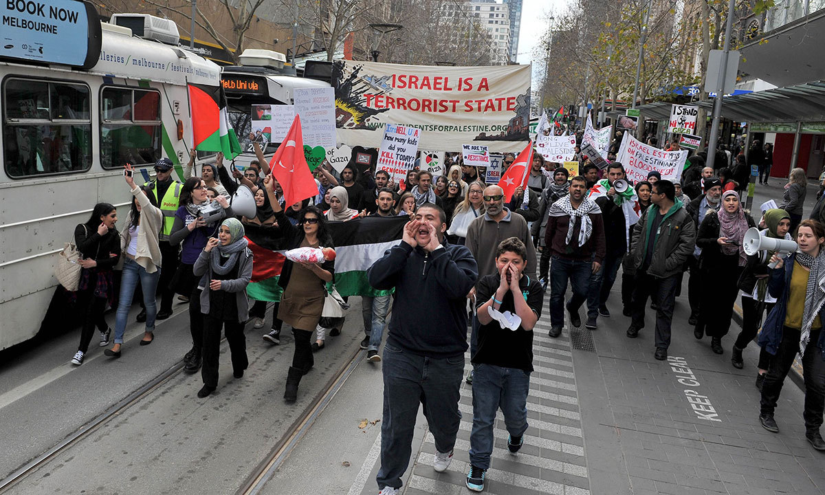 Demonstrators chant anti-Israel slogans as they march down Swanston Street as part of a protest organised in support of the Global Day of Rage against Israel's actions in Gaza in Melbourne. AFP