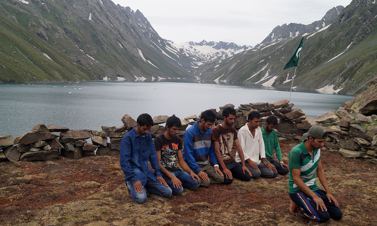 Kashmiri Muslims praying after trekking the mountains to reach the pictureseque Kounsarnag Lake. — Haziq Qadri