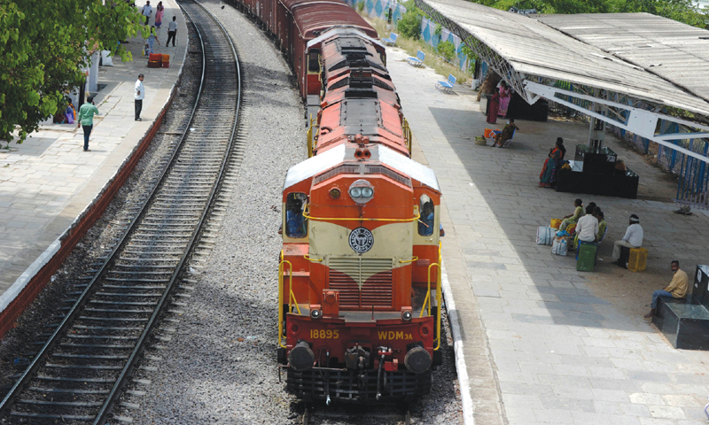 AN Indian goods train waits at a railway  station in Hyderabad. India's cabinet agreed on August 7 to increase the limit on foreign direct investment in defence industry to 49 from 26pc, and allow unlimited investment in railway  infrastructure.—AFP