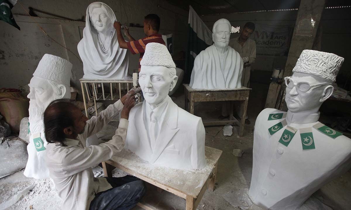 Pakistani artist Mubarak Hussain puts the final touches on a statue of Muhammad Ali Jinnah, founder of Pakistan ahead of Pakistan's Independence Day | Reuters