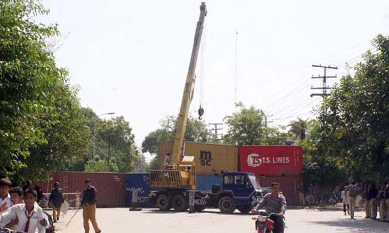 Policemen moving containers in Lahore. — File photo