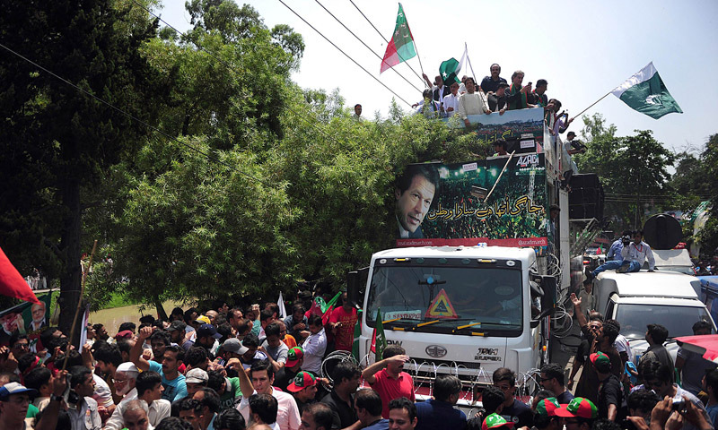 — AFP Photo shows Imran Khan stands with other leaders as he heads a protest march from Lahore to Islamabad against the government, in Lahore on August 14
