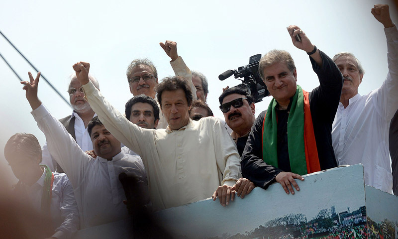 — AFP Photo shows Imran Khan waving as he heads a protest march from Lahore