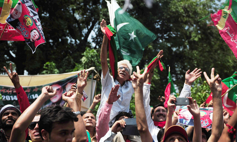 — AFP Photo shows supporters cheering for Imran Khan as he heads a protest march from Lahore to Islamabad against the government