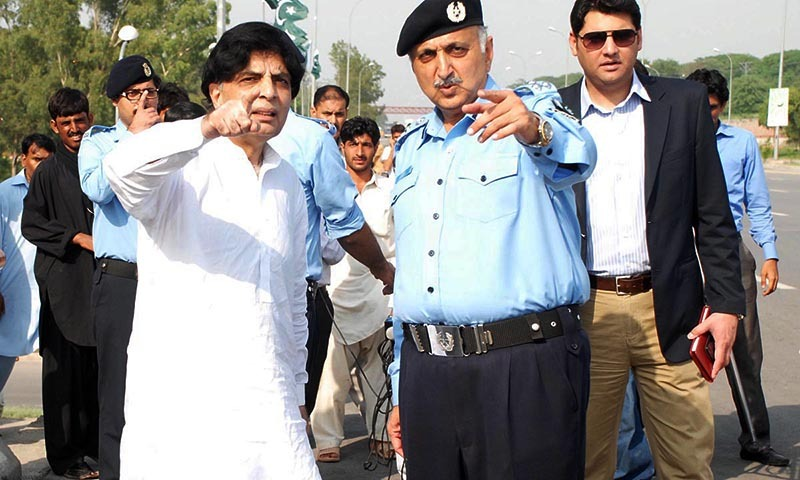 Federal Interior Minister Chaudhry Nisar Ali Khan reviewing the security arrangements for the participants of PTI Azadi March and Inqilab March.— Photo by Online