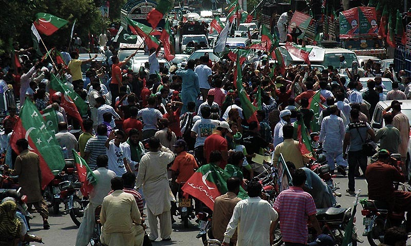 Activists of Pakistan Tahreek-i-Insaf taking part in Azadi March in Lahore. — Photo by Online