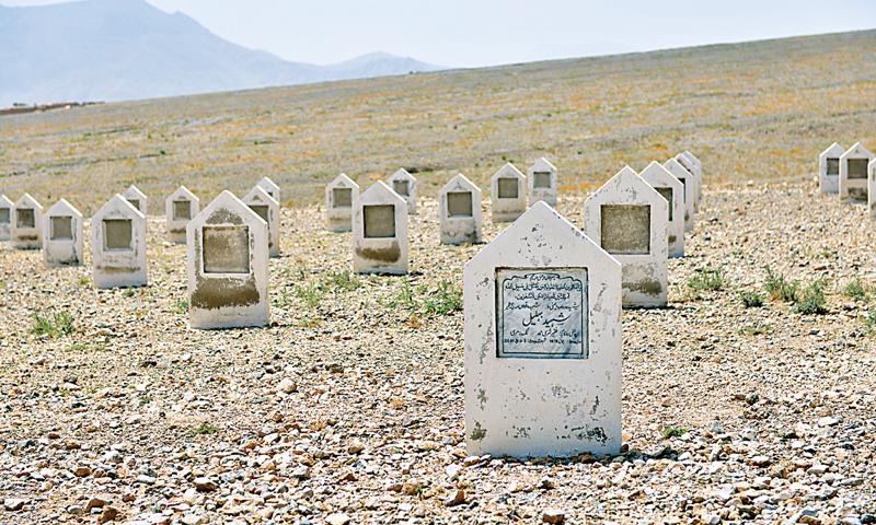 ROWS of white plaques are placed at a graveyard in Marri Camp, near Shalkot, outside Quetta. Some of the memorials carry names of the missing persons while others are still blank.—Fahim Siddiqi / White Star