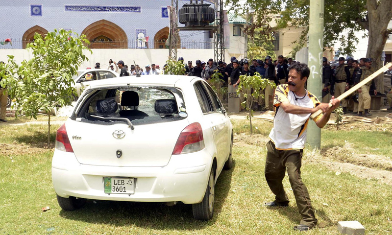 Gulllu butt breaking the windows of a car during clash between police and  Pakistan Awami Tehreek (PAT) workers in Model Town. — File photo