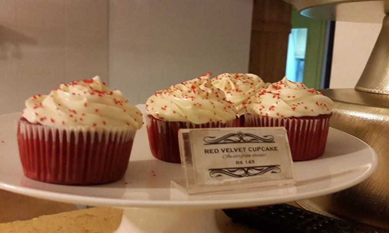 Red Velvet cupcakes displayed on the counter – Photo by author