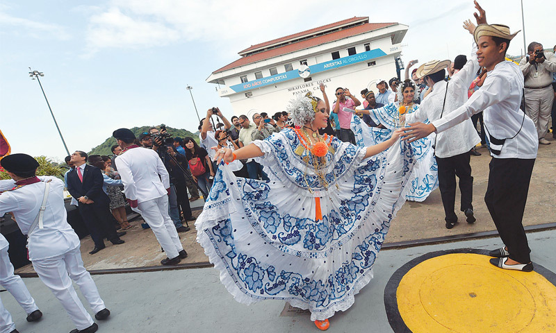 PANAMA: Dancers perform during celebrations of the 100th anniversary of the Panama Canal on Friday.—AFP