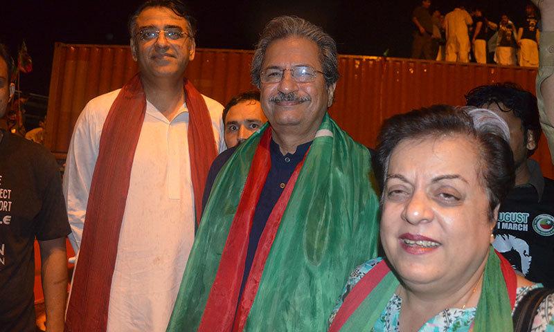 PTI leaders Asad Umer, Arif Alvi and Shireen Mazari. — Photo by Irfan Haider