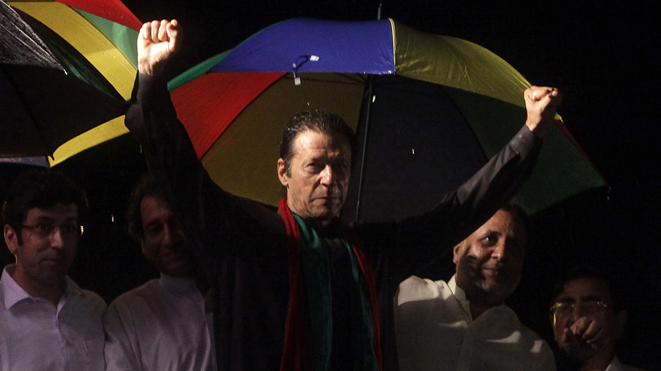 Imran Khan (C), chairman of Pakistan Tehreek-e-Insaf (PTI) political party, gestures to his supporters during the Freedom March in Islamabad August 16, 2014 — Reuters Photo