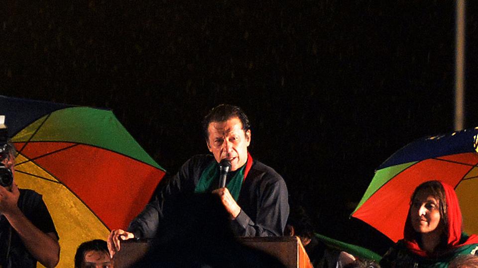 Imran Khan addresses the crowd.— AFP photo