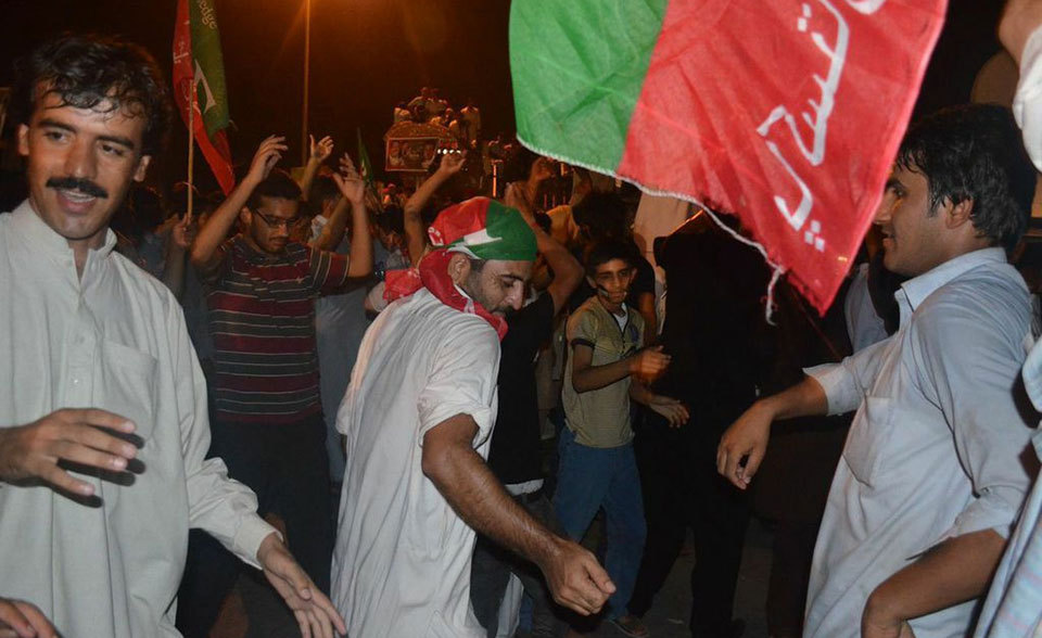 PTI supporters in festive mood in Islamabad. - Photo by Irfan Haider