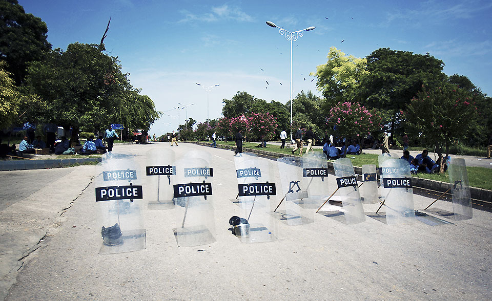 Police leave their shields at a road as the government relaxes its restrictions to stop anti-government marchers in Islamabad, Pakistan, Aug. 16, 2014.  — Photo by AP