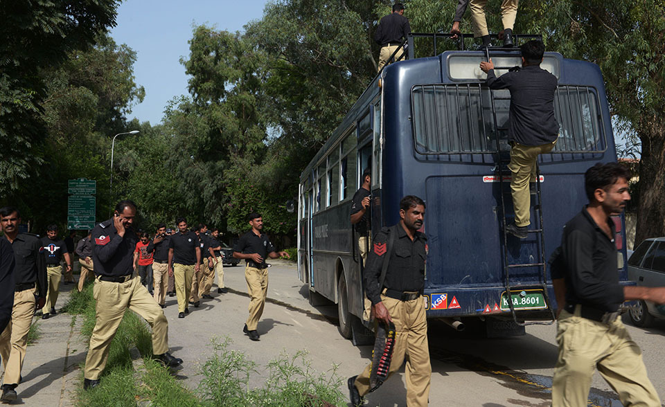 Punjab Police personnel arrive to reinforce security during an anti-government protest in Islamabad on August 17, 2014. — Photo by AFP