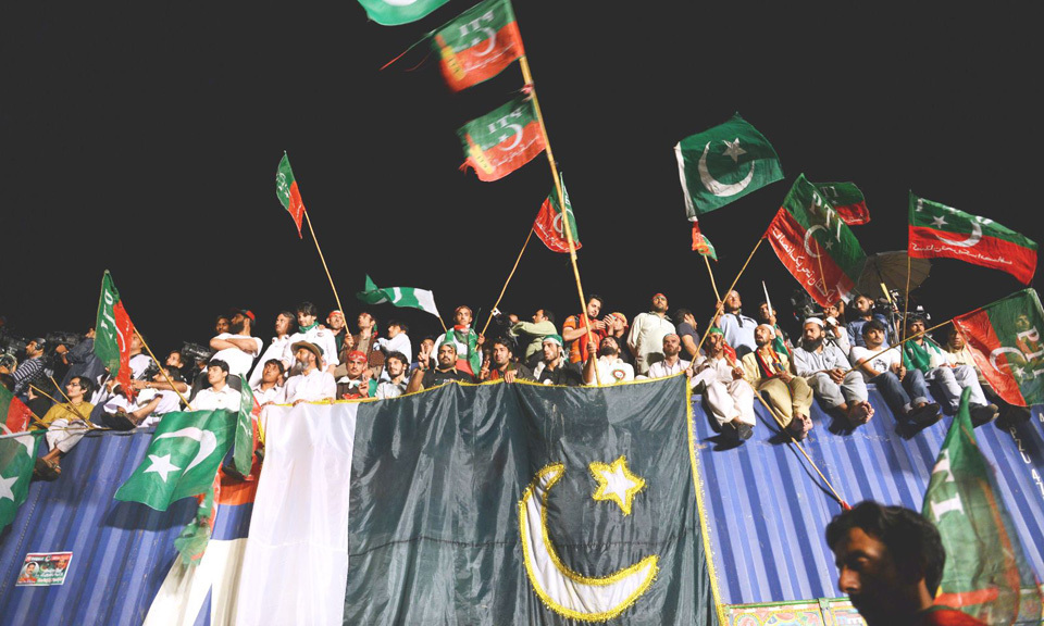 Pakistani supporters of cricketer-turned-politician Imran Khan attend a protest march - AFP