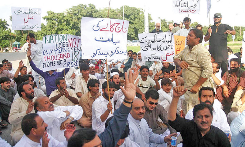 Traders protest outside the National Press Club on Sunday. — Photo by Online