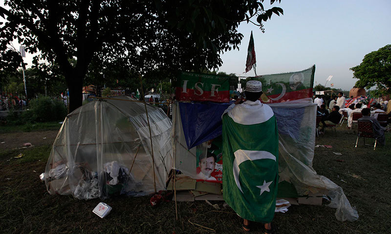 A PTI supporter in Islamabad. — Reuters photo