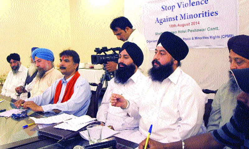 A member of Sikh community speaks at a seminar in Peshawar on Monday. — White Star