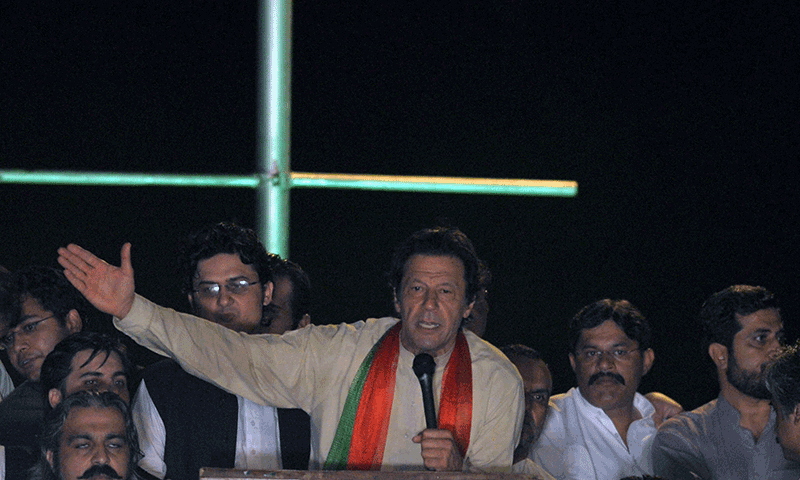 akistani opposition politician Imran Khan (C) addresses the supporters during a protest march against the country's Pakistan Muslim League-Nawaz-led government in Islamabad on August 18, 2014. — Photo by AFP